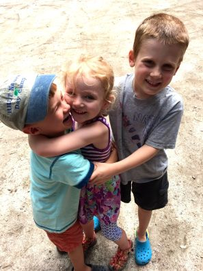 Lucy, caleb and knowlton hugs